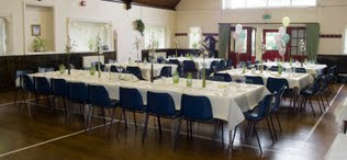 An image Sleights Village hall main room set for a wedding