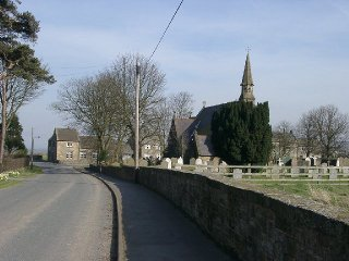 A view along the road in Ugthorpe showing the spire of Christ Church